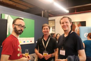 Stefano Zacchiroli: Debian Project Leader (on the left), Daniel Pocock from Debian (in the middle), John Sullivan from Free Software Foundation (on the right)